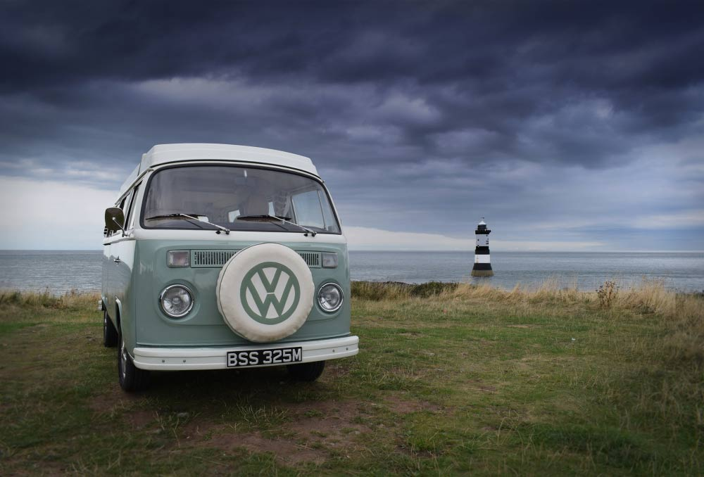 Bessie our VW campervan with view of Penmon Head lighthouse