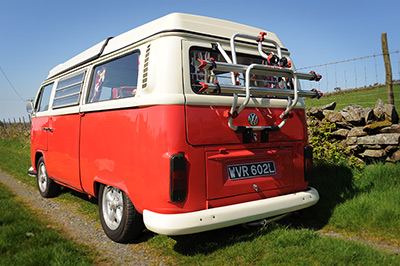 Red VW campervan Poppy with a bike rack